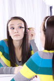 Teenager Putting on Make Up Royalty Free Stock Image