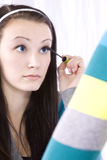 Teenager Putting on Make Up Stock Image