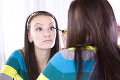 Teenager Putting on Make Up Stock Images