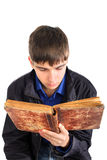 Teenager read book. Teenager reads old book isolated on the white Royalty Free Stock Photos