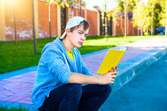 Teenager read a Book Stock Photo