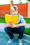 Teenager read a Book Royalty Free Stock Photography