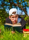 Teenager read a Book. S on the Grass Royalty Free Stock Image