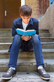 Teenager read the Book outdoor Stock Photography