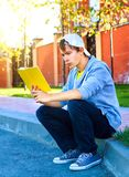 Teenager read a Book Stock Images