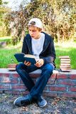 Teenager read a Book. S in the Park Royalty Free Stock Photos