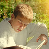 Teenager read the Book Stock Image