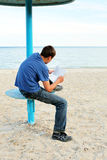 Teenager read letter outdoor Stock Photo