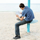 Teenager read Letter outdoor Royalty Free Stock Images