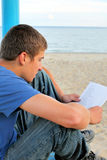 Teenager read paper outdoor Royalty Free Stock Images