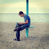 Teenager reading on the Beach Royalty Free Stock Images