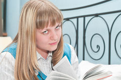 Teenager reading book Stock Photos