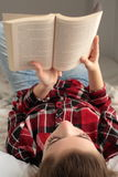 Teenager reading a book Stock Photography