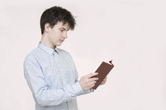 Teenager reading a book Stock Photos