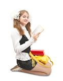 Teenager reading book over white Royalty Free Stock Photography