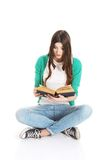 Teenager reading book. Pretty teenager reading interesting book Stock Photos
