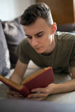 Teenager reading a book Royalty Free Stock Image