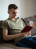 Teenager reading a book Stock Image