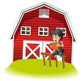 A teenager reading near the barnhouse Royalty Free Stock Photography