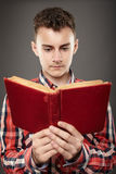 Teenager reading an old book Royalty Free Stock Image