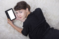 Teenager Reading on a Tablet Stock Image
