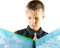 Teenager reads book Royalty Free Stock Image