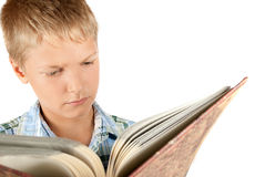 Teenager reads book. Reception of formation. Isolation on white Royalty Free Stock Image