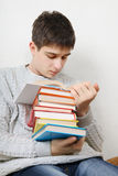 Teenager reads a Books Stock Images