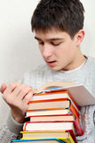 Teenager reads a Books Stock Photo