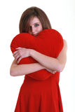 Teenager with red heart. On white background Stock Photo