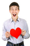 Teenager with Red Heart Shape. Surprised Teenager with Red Heart shape Isolated on the White Background Royalty Free Stock Photo