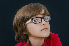 Teenager in red polo shirt and glasses looking at camera Royalty Free Stock Images