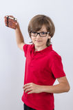 Teenager in red polo shirt and glasses is throwing his notebook Stock Photography