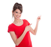 Teenager in red shirt pointing with her finger. Stock Photos