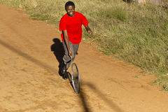 Teenager In Red T-Shirt, Playing with Wheel Stock Photo