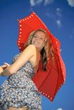 Teenager with  red umbrella Royalty Free Stock Image