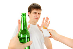 Teenager refuse a Cigarette and Beer. Teenager refuse a Cigarette and the Beer Isolated on the White Background Royalty Free Stock Images