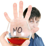 Teenager refuses Alcohol. Teenager show STOP gesture to Alcohol on the White Background stock photos