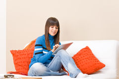 Teenager relax with touch screen tablet computer Royalty Free Stock Images