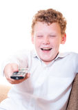 A teenager with a remote control. In the room Royalty Free Stock Photos