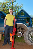 The teenager repairs the car Royalty Free Stock Photo