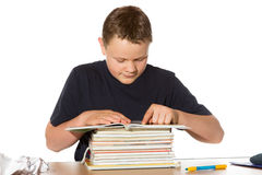 Teenager researching his homework Stock Image