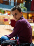Teenager in a restaurant Stock Images