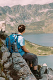 Teenager resting in the mountains Stock Image
