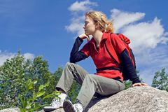Teenager resting outdoors Stock Photos