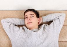 Teenager resting on Sofa Stock Photography