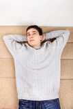 Teenager resting on Sofa. At the Home Stock Images