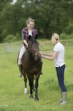 Teenager riding bareback on her pony Royalty Free Stock Images