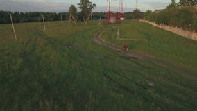 Teenager riding bike in the country, aerial view stock video footage