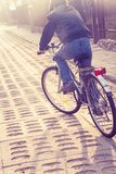 Teenager riding bike on street Royalty Free Stock Photography